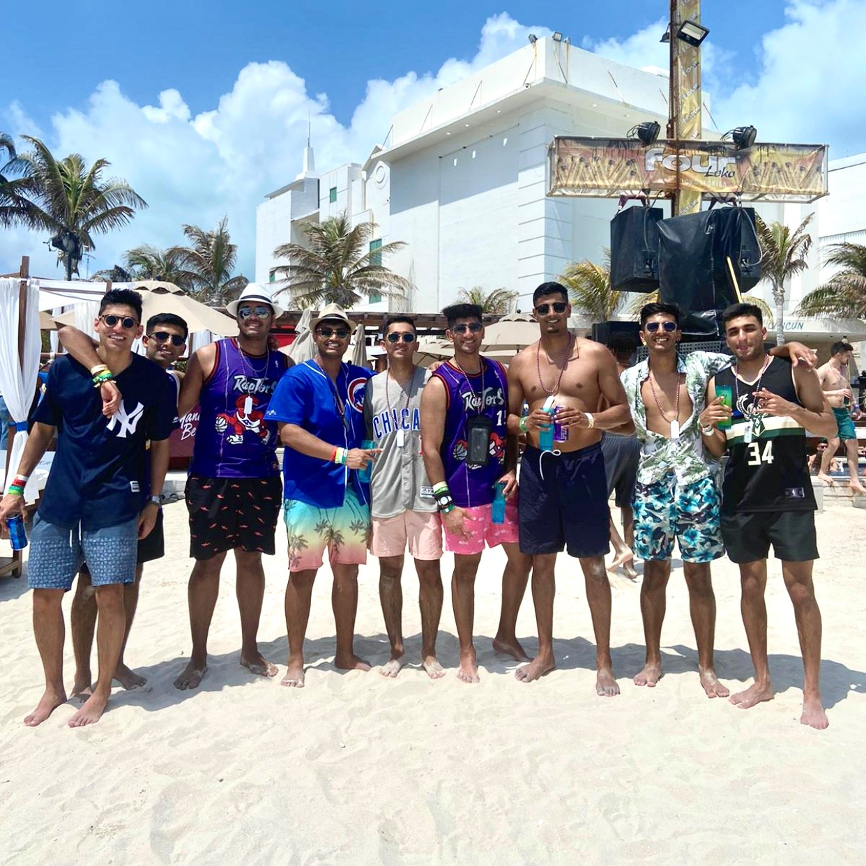 Group of guys on the beach celebrating bachelor party