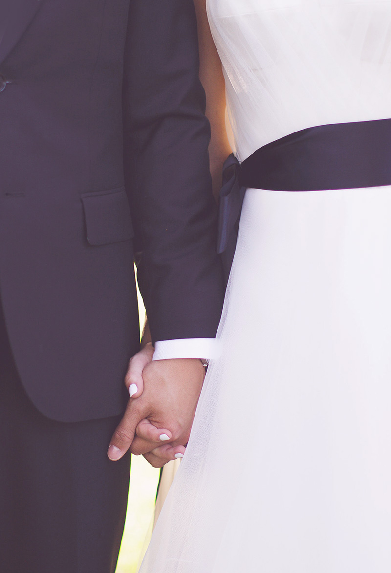 Event Planning Bride and Groom Holding Hands